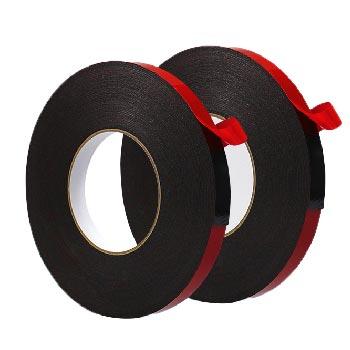 两卷红皮黑棉立着摆放的PE胶带